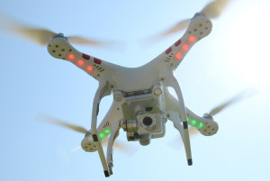 A camera is mounted to the base of a Bill Scott's aerial drone he flies the device Wednesday, June 11, 2014, at his Kinston, N.C., home. He can view what the camera is seeing from his cell phone. (AP Photo/The Free Press, Janet S. Carter)